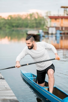 Kayaking concept with young man