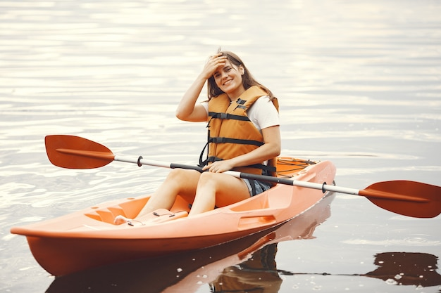 Kayaking. a woman in a kayak. girl paddling in the water.