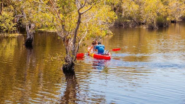 Kayaks couple on the river