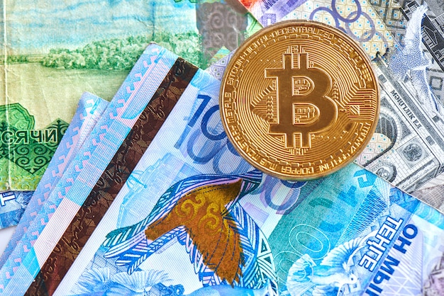Kazakh tenge money and cryptocurrency bitcoin close-up. digital virtual internet currency investment concept