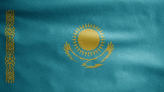 Казахстанский флаг развевается на ветру. крупным планом казахстанского флага, мягкого и гладкого шелка. предпосылка прапорщика текстуры ткани ткани. используйте его для концепции национального дня и страны.