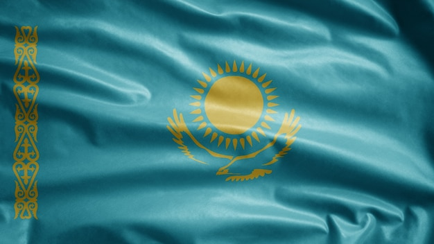 Kazakhstani flag waving in the wind. close up of kazakhstan banner blowing, soft and smooth silk. cloth fabric texture ensign background.
