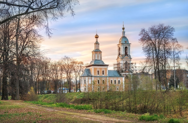 Kazan church with a bell tower in uglich among trees without leaves