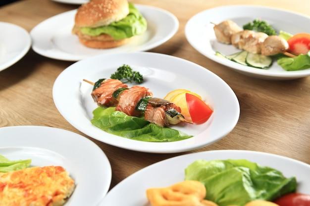 Kebab,burger and salads on the table