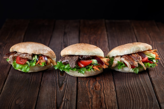 Kebab sandwich on wooden background