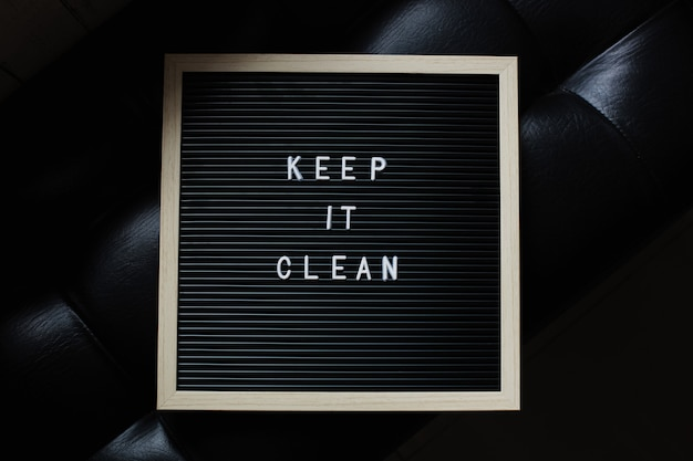 Keep it clean letter board quote on black background