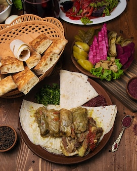 Kelem dolmasi, cabbage leaves stuffed with meat and rice, with beef stew with vegetables in lavash.