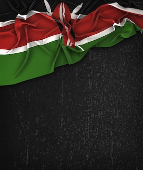 Kenya flag vintage on a grunge black chalkboard with space for text
