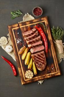 Keto ketogenic diet grilled fried beef steak, striploin, sliced potatoes