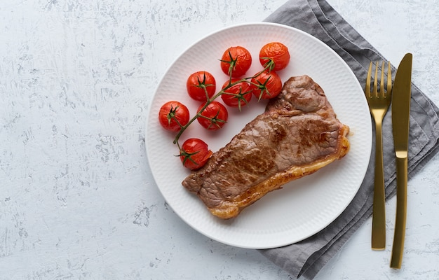 Keto ketogenic diet steak with tomatoes on white background