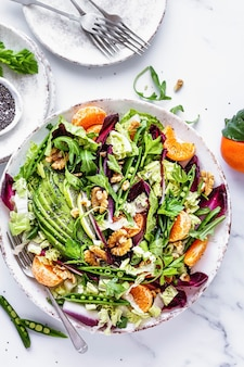 Keto salad with clementines and avocado healthy food