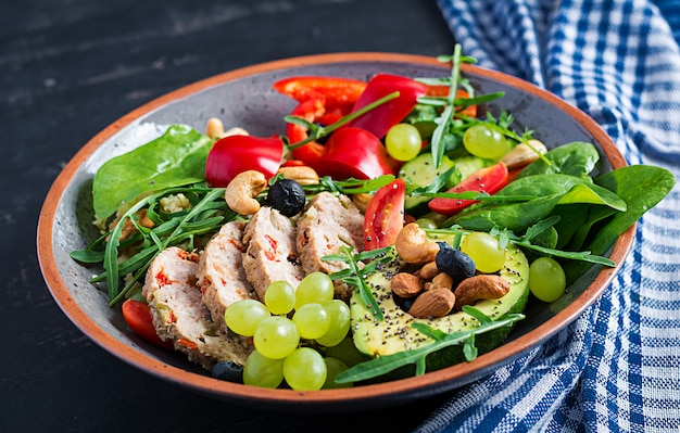 Ketogenic diet. buddha bowl dish with meatloaf, avocado, sweet pepper, tomato, cucumber, berries and nuts. detox and healthy superfoods bowl concept.