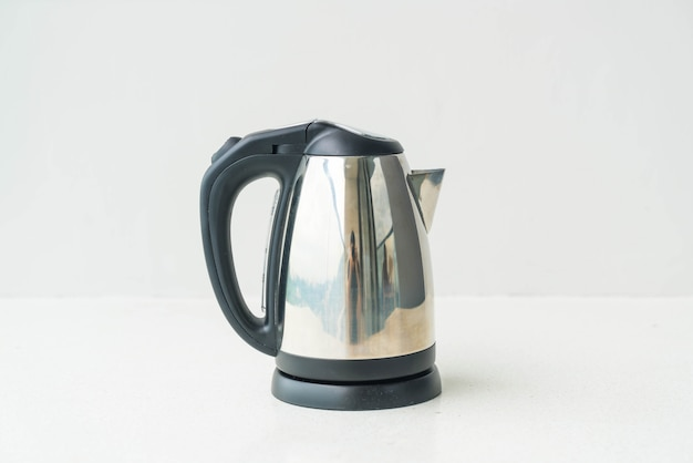 Kettle and cup  on wall background