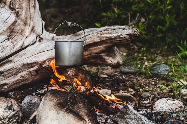 Kettle hanging over fire