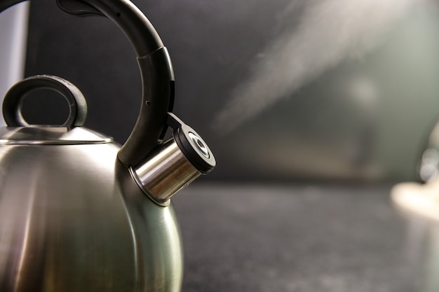 Kettle with boiling water close up