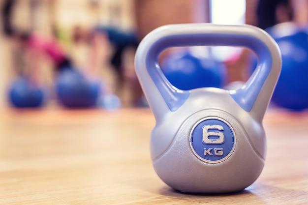 Kettlebel. kettlebell in gym on floor. toned image.