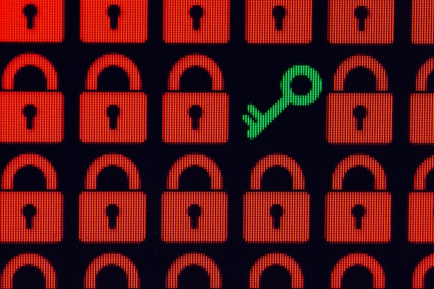 Key as a symbol of access or hacking of open personal information red pixel locks and a green key