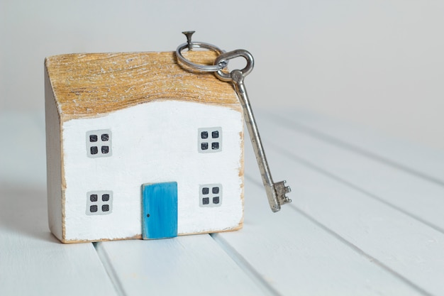 Key and house, the concept of real estate acquisition, mortgage.