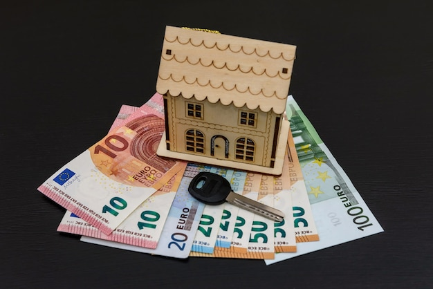 Key and house model on euro banknotes