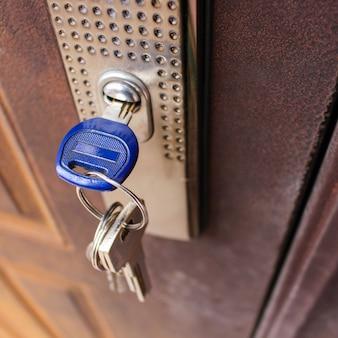 Key in the lock of iron door.