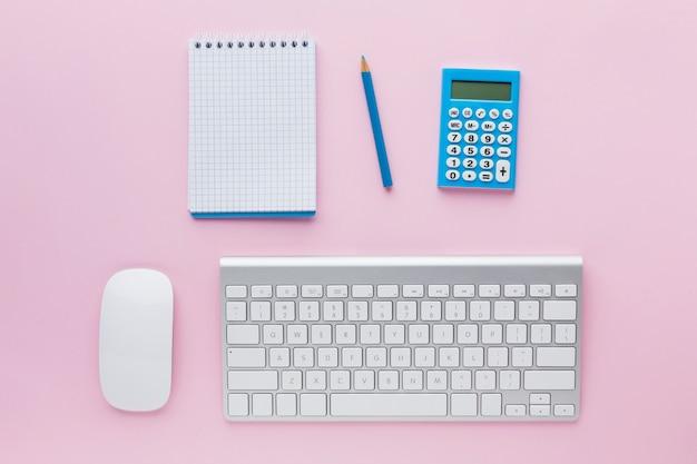 Keyboard and blank notepad flat lay