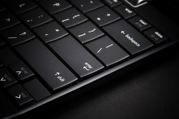 A keyboard button on the laptop