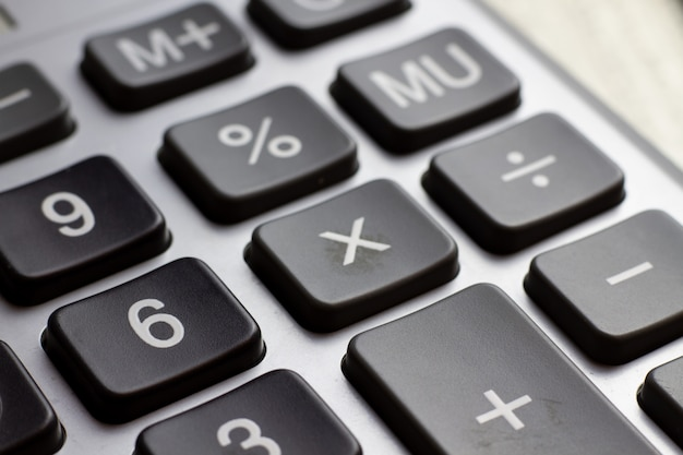 Keyboard calculator close-up. business concept of economy finance loan collateral mortgage loan rates increase.