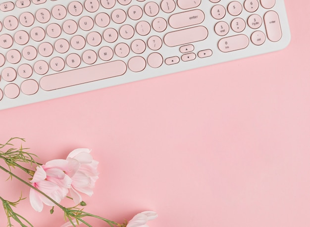 Keyboard and flowers copy space