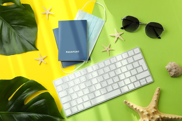 Keyboard, passports with mask and vacation accessories