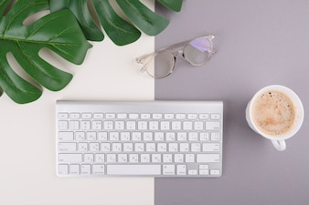 Keyboard with coffee cup and glasses