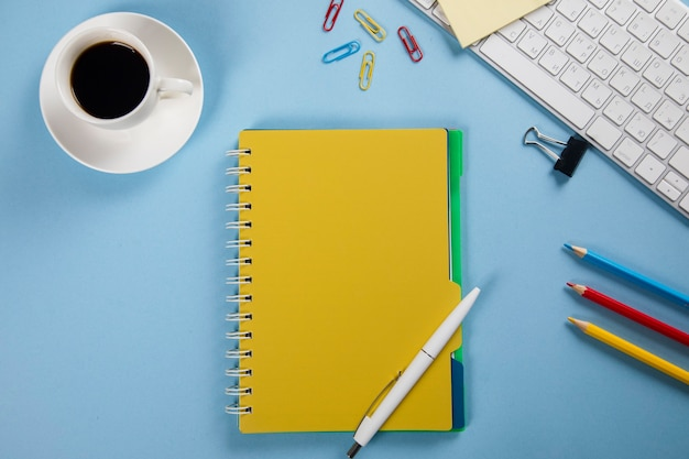 Keyboard with notepad and stationary and coffee