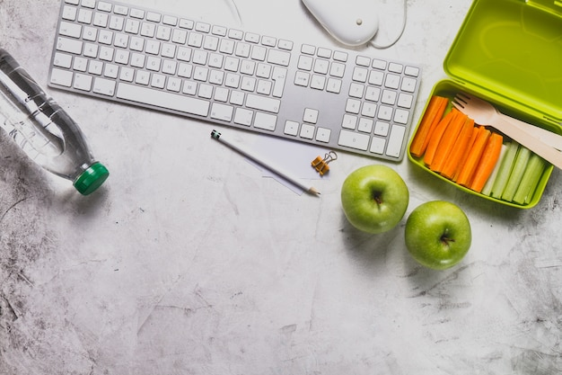 Keyboard with water bottle and healthy food