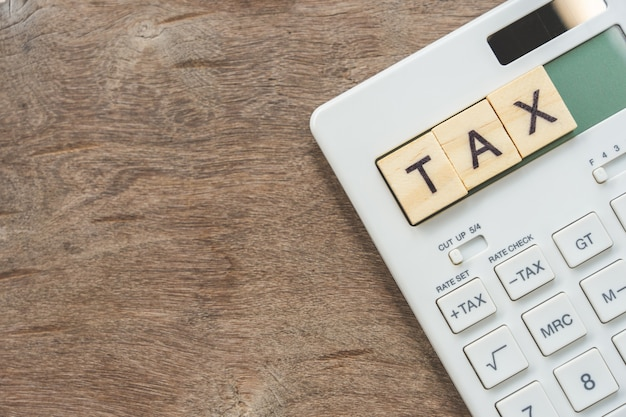Keypad tax button for tax calculation. easy to calculate. on white calculator
