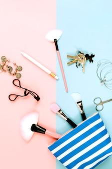 Keys and beauty supplies near makeup bag