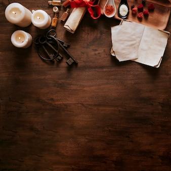 Ключи рядом с свечами и ингредиентами