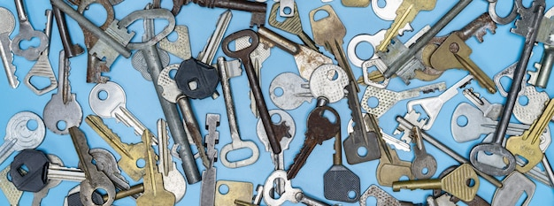 Keys set on blue background. door lock keys and safes for property security and house protection.