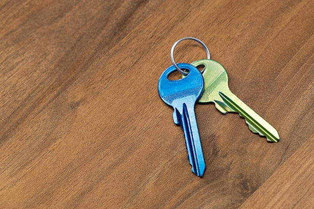 Keys on wooden table surface rent sell buy apartment estate business
