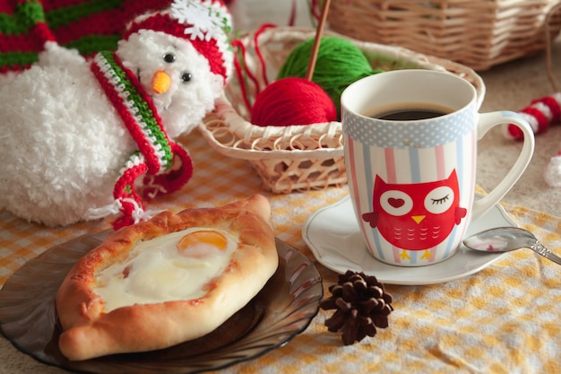 Khachapuri in adjara with the egg. the georgian cuisine. christmas winter