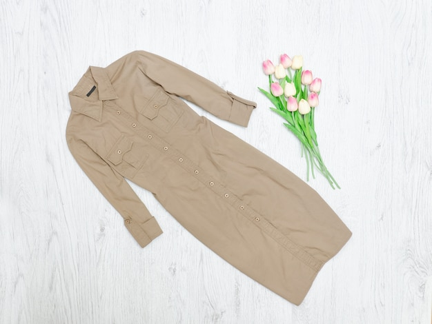 Khaki dress and a bouquet of tulips. fashionable concept