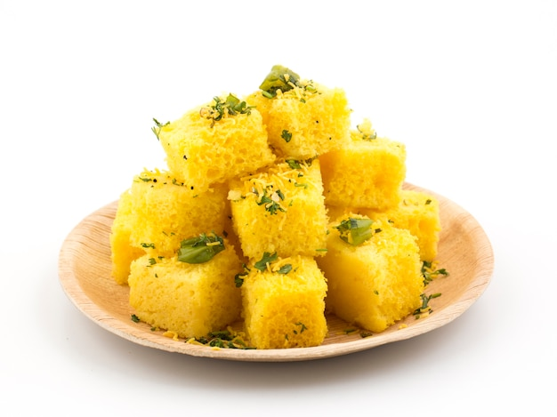 Indian traditional street food khaman dhokla served with chutney