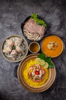 Khao soi udon then ingredients are chicken, pork, shrimp.