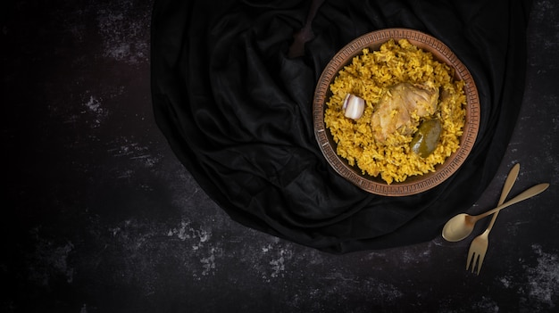 Khichuri or khichdi or khichri in a dark background with a space for text or messages