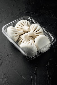 Khinkali dumplings with beef and lamb meat in plastic tray