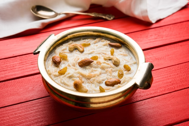 Khir or kheer payasam also known as sheer khurma seviyan consumed especially on eid or any other festival in india or asia. served with dry fruits toppings in a bowl