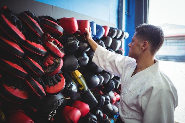Kick boxer choosing gloves