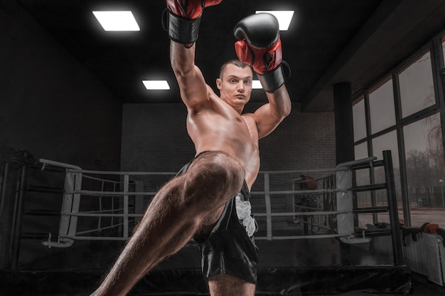 Kickboxer in the gym. knee kick. mixed martial arts. sports concept.