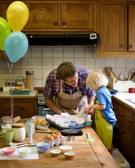 Kid baking with dad