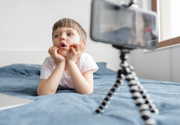 Kid in bed with smartphone
