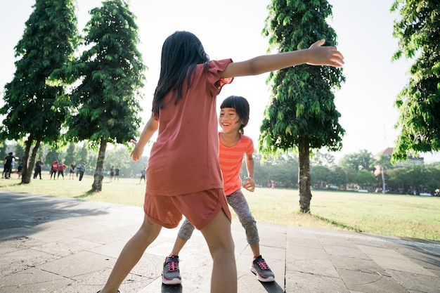 Kid catch and play together outdoor with friend
