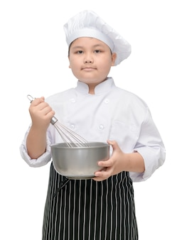 Kid chef hold whisk with cook hat and apron
